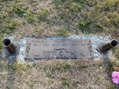Burial marker for Tom Wilson and his parents—with Wilson's incorrect death year (1978)
